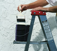 Man on Ladder with Paint - Exterior Painting